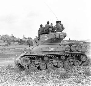 Troops on top of a single tank