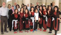 Children in traditional Palestinian dresses
