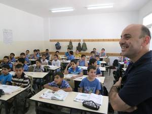 Teacher in class at a Nablus boys' school